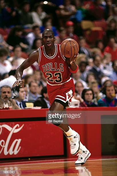 Michael Jordan of the Chicago Bulls moves the ball upcourt during the 1990 NBA game against the Houston Rockets in Houston Texas NOTE TO USER User...