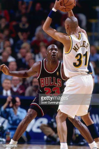 Michael Jordan of the Chicago Bulls on guard during the game against the Indiana Pacers on April 9 1997 at the Market Square Arena in Indianapolis IN...