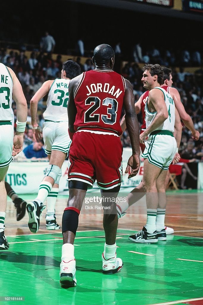 Michael Jordan #23 of the Chicago Bulls on the court against the Boston Celtics during a game played in 1990 at the Boston Garden in Boston, Massachusetts.