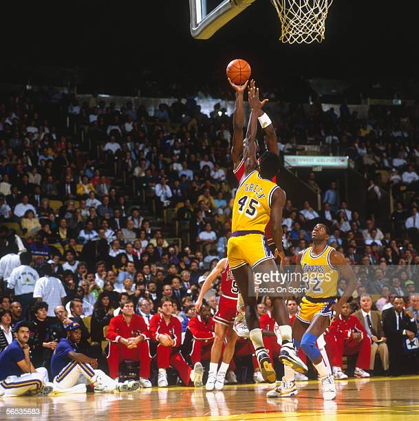 Michael Jordan of the Chicago bulls over blocking AC Green of the Los Angeles Lakers circa the 1980's during a game