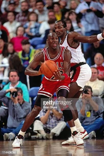 e6179622878 Michael Jordan of the Chicago Bulls passes against Clyde Drexler of the Portland  Trailblazers during the
