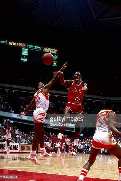 Michael Jordan of the Chicago Bulls passes against the Atlanta Hawks during his rookie season of 1984 at the Omni in Atlanta, Georgia. NOTE TO USER:...