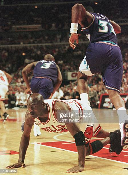 Michael Jordan of the Chicago Bulls picks himself off the court after Karl Malone of the Utah Jazz scored a basket 12 June during game five of the...