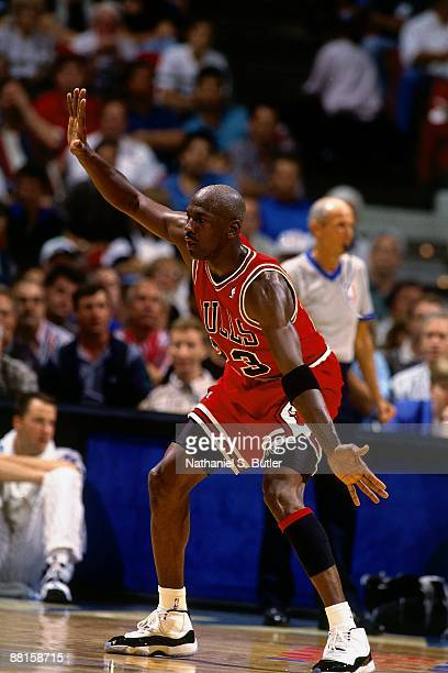 Michael Jordan of the Chicago Bulls plays defense against the Orlando Magic in Game Two of the Eastern Conference Semifinals during the 1995 NBA...