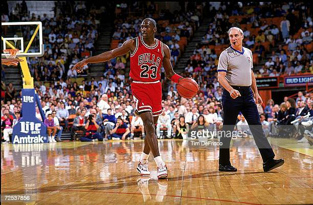 Michael Jordan of the Chicago Bulls points and walks with the ball during the game Mandatory Credit Tim DeFrisco /Allsport