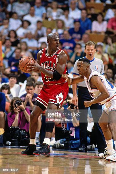 Michael Jordan of the Chicago Bulls posts up against Terrell Brandon of the Cleveland Cavaliers circa 1991 at the Richfield Coliseum in Richfield...