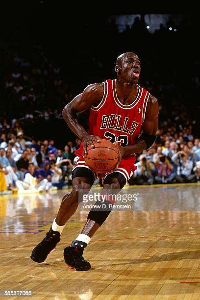 Michael Jordan of the Chicago Bulls pulls up to shoot the ball in Game Three of the NBA Finals against the Los Angeles Lakers on June 7 1991 at Great...