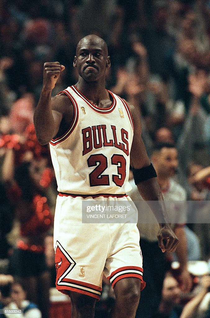 c06b05882b14b0 Michael Jordan of the Chicago Bulls pumps his fist after scoring the ...