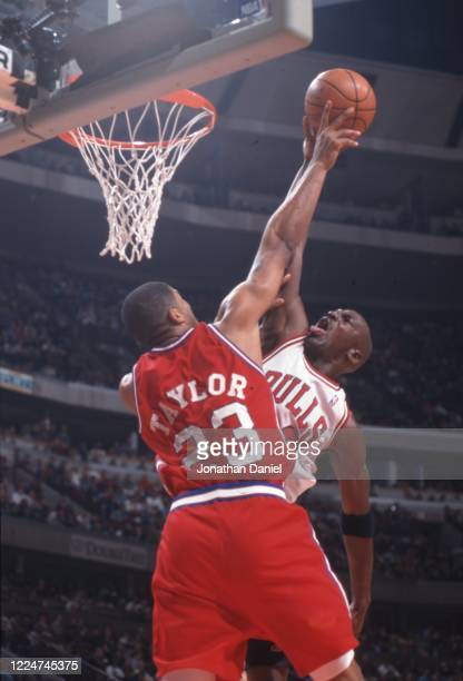 Michael Jordan of the Chicago Bulls puts up a shot against Maurice Tayler of the Los Angeles Clippers at the United Center on December 23 1997 in...