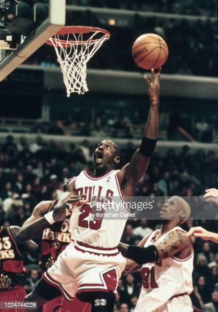 Michael Jordan of the Chicago Bulls puts up a shot against the Atlanta Hawks at the United Center on December 27 1997 in Chicago Illinois