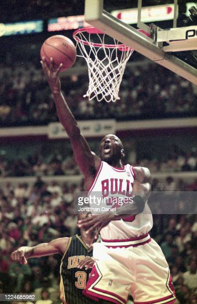 Michael Jordan of the Chicago Bulls puts up a shot against the Indiana Pacers in the 1998 NBA Eastern Conference playoffs at the United Center in May...