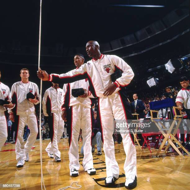 Michael Jordan of the Chicago Bulls raises the 1996 championship banner during a game played on November 2 1996 at the United Center in Chicago...