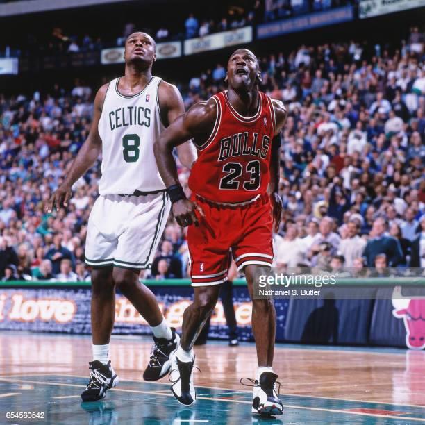 Michael Jordan of the Chicago Bulls rebounds against the Boston Celtics on October 31 1997 at the Fleet Center in Boston Massachussetts NOTE TO USER...