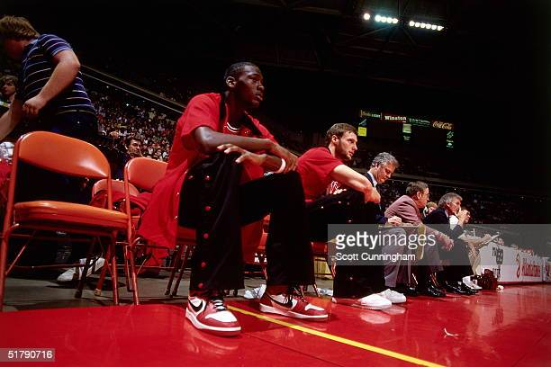 Michael Jordan of the Chicago Bulls rests on bench against the Atlanta Hawks during an NBA game circa 1986 at the Omni in Atlanta Georgia NOTE TO...