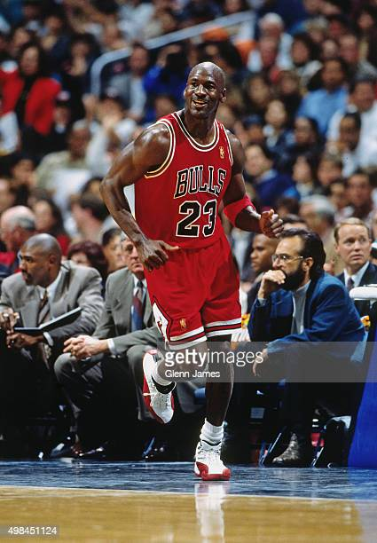 Michael Jordan of the Chicago Bulls runs after scoring his 25000th career point against the San Antonio Spurs on November 30 1996 at the Alamo Dome...