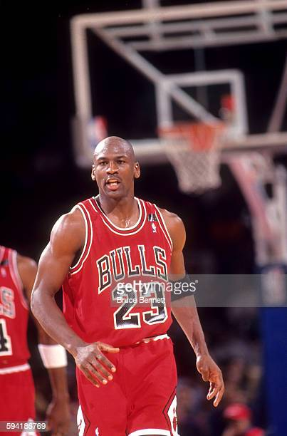 Michael Jordan of the Chicago Bulls runs on the court during a game in the 1991 Eastern Conference Semifinals against the Philadelphia 76ers in May...