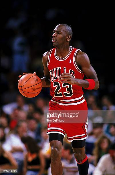 Michael Jordan of the Chicago Bulls runs with the ball during the game Mandatory Credit Tim DeFrisco /Allsport