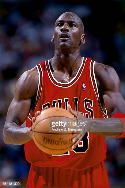 Michael Jordan of the Chicago Bulls shoots a foul shot during a game in 1998 at XX in XX XX NOTE TO USER User expressly acknowledges and agrees that...
