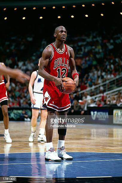 Michael Jordan of the Chicago Bulls shoots a free throw wearing jersey for the only time in his career due to the fact that his jersey was stolen...