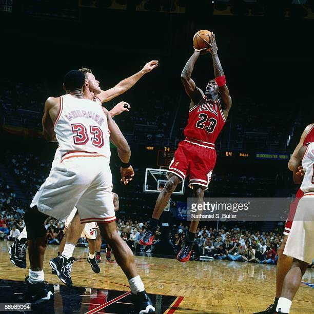 Michael Jordan of the Chicago Bulls shoots a jump shot against Dan Majerle of the Miami Heat in Game Four of the Eastern Conference Finals during the...