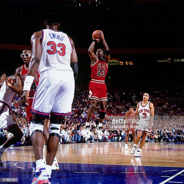 Michael Jordan of the Chicago Bulls shoots a jump shot against Patrick Ewing of the New York Knicks during a game circa 1992 at Madison Square Garden...