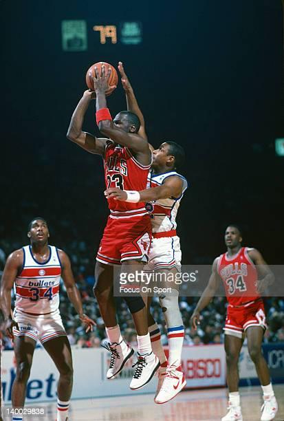 Michael Jordan of the Chicago Bulls shoots a jump shot against the Washington Bullets during an NBA basketball game circa 1986 at the Capital Centre...