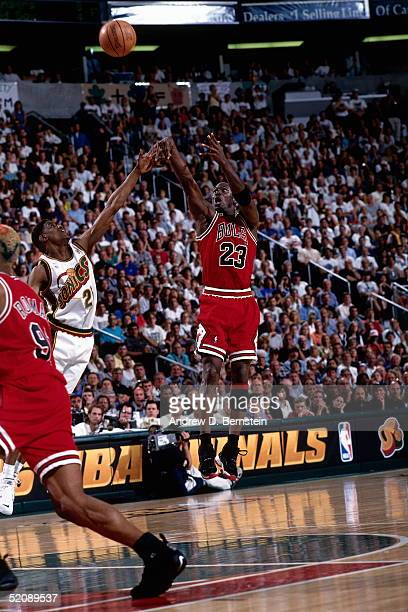 Michael Jordan of the Chicago Bulls shoots a jump shot against the Seattle Sonics during Game five of the 1996 NBA Finals at Key Arena on June 14...