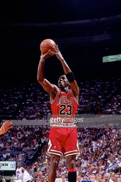 Michael Jordan of the Chicago Bulls shoots a jump shot against the Cleveland Cavaliers during a game circa 1991 at the Richfield Coliseum in...