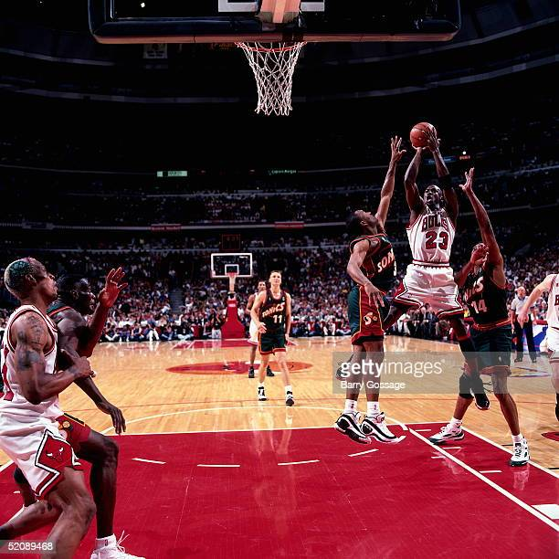 Michael Jordan of the Chicago Bulls shoots a jump shot in the lane against the Seattle Sonics during Game six of the 1996 NBA Finals at United Center...