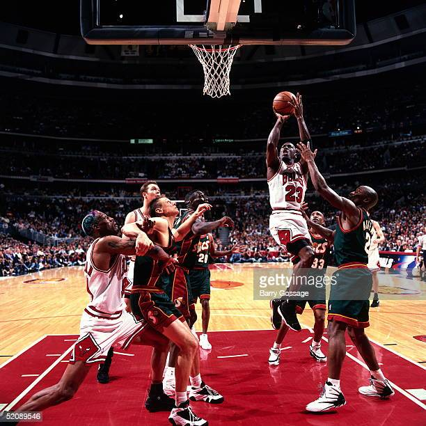 Michael Jordan of the Chicago Bulls shoots a jump shot in the lane against the Seattle Sonics during Game two of the 1996 NBA Finals at United Center...