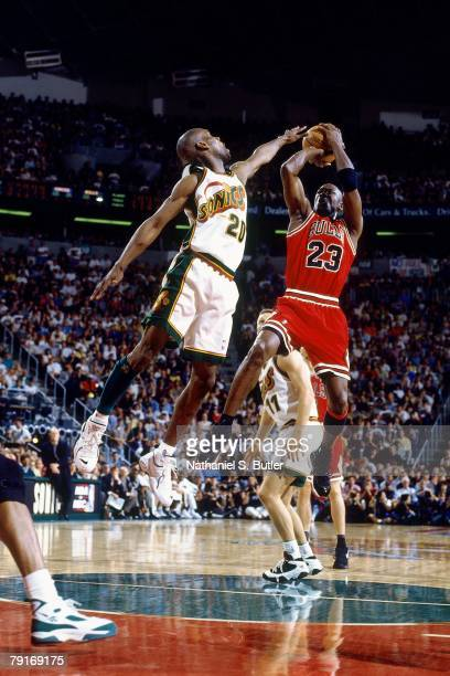 Michael Jordan of the Chicago Bulls shoots a jump shot over Gary Payton of the Seattle SuperSonics in Game Three of the 1996 NBA Finals at Key Arena...