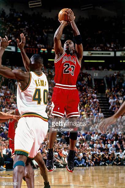 Michael Jordan of the Chicago Bulls shoots a jump shot over Shawn Kemp of the Seattle SuperSonics in Game Five of the 1996 NBA Finals at Key Arena on...