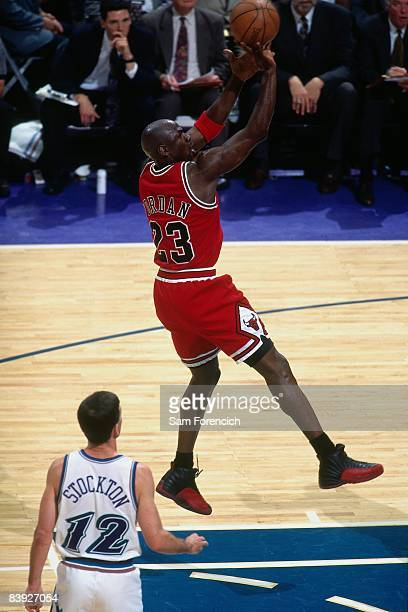 Michael Jordan of the Chicago Bulls shoots a jumper against John Stockton of the Utah Jazz in Game Three of the 1997 NBA Finals at the Delta Center...