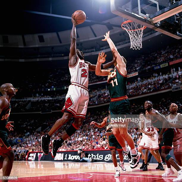 Michael Jordan of the Chicago Bulls shoots a jumphook from the baseline against the Seattle Sonics during Game six of the 1996 NBA Finals at United...
