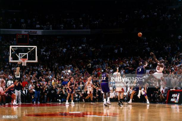 Michael Jordan of the Chicago Bulls shoots a last second shot against the Utah Jazz in Game Five of the 1998 NBA Finals at the United Center on June...