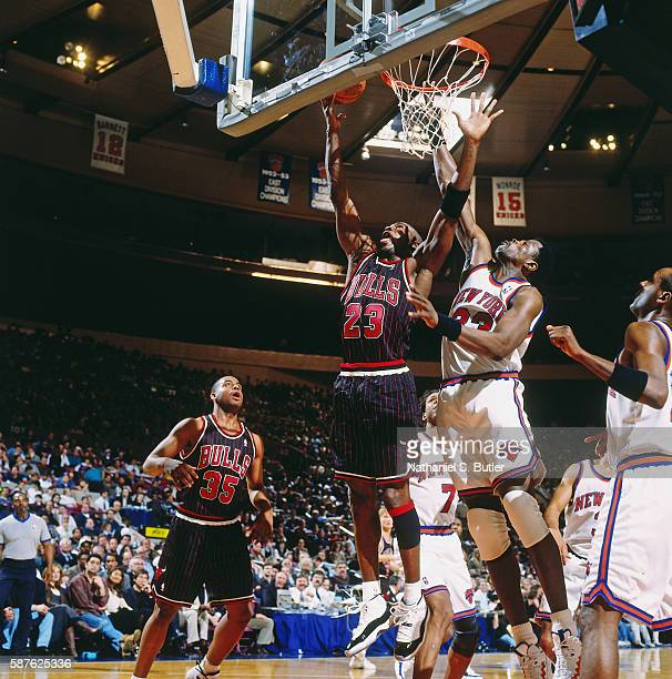 Michael Jordan of the Chicago Bulls shoots a lay up against Patrick Ewing of the New York Knicks on March 10 1996 at Madison Square Garden in New...