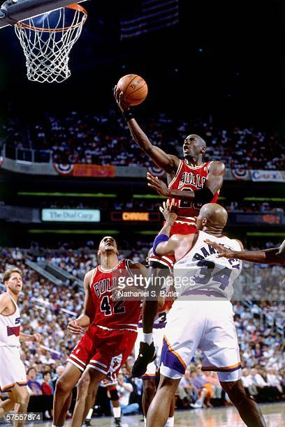 Michael Jordan of the Chicago Bulls shoots a layup against Charles Barkley of the Phoenix Suns during a game of the NBA Finals on June 9 1993 at the...
