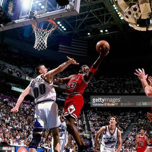 Michael Jordan of the Chicago Bulls shoots a layup against Greg Ostertag of the Utah Jazz during Game 5 of the NBA Finals on June 11 1997 at the...