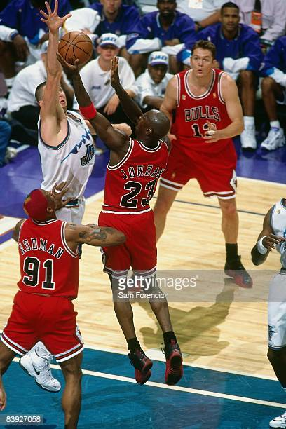 Michael Jordan of the Chicago Bulls shoots a layup against Greg Ostertag of the Utah Jazz in Game Four of the 1997 NBA Finals at the Delta Center on...