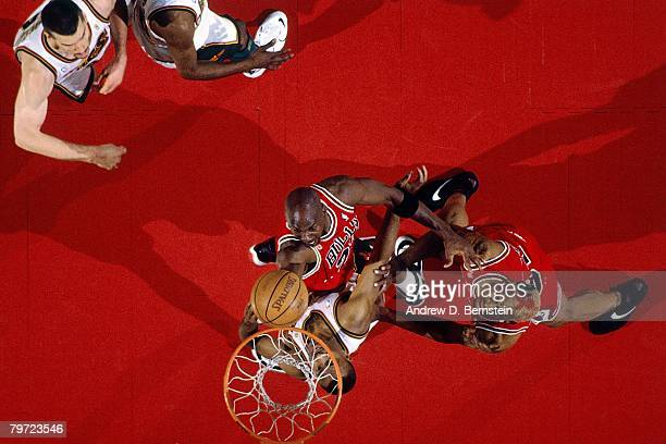 Michael Jordan of the Chicago Bulls shoots a layup against Hersey Hawkins of the Seattle SuperSonics in Game Five of the 1996 NBA Finals at Key Arena...