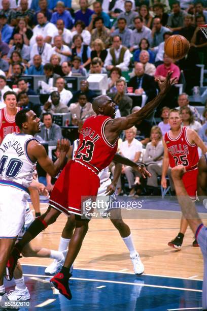 Michael Jordan of the Chicago Bulls shoots a layup against Shandon Anderson of the Utah Jazz in Game One of the 1998 NBA Finals at the Delta Center...