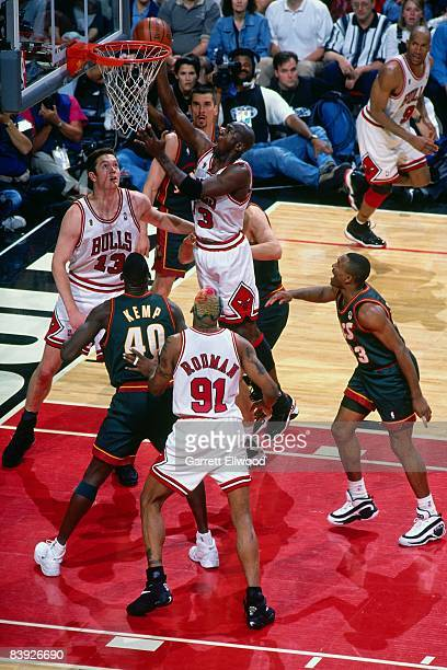 MIchael Jordan of the Chicago Bulls shoots a layup against Shawn Kemp of the Seattle Supersonics during Game Six of the 1996 NBA Finals on June 16 at...