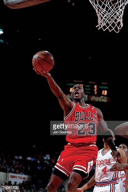 Michael Jordan of the Chicago Bulls shoots a layup against the Los Angeles Clippers during a game played in 1993 at the Los Angeles Sports Arena in...
