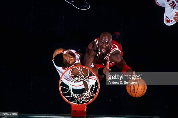 Michael Jordan of the Chicago Bulls shoots a layup against the Miami Heat in Game Three of the Eastern Conference Finals during the 1997 NBA Playoffs...
