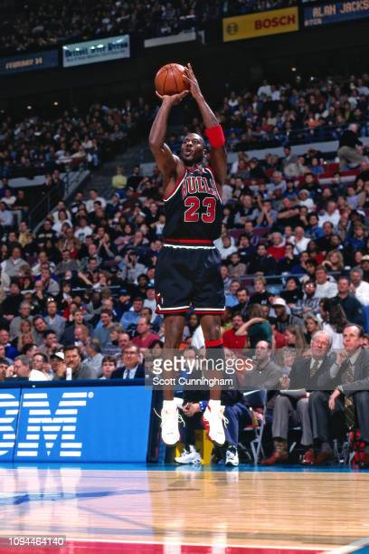 Michael Jordan of the Chicago Bulls shoots a three point basket against the Detroit Pistons on January 3 1998 at The Palace of Auburn Hills in Auburn...