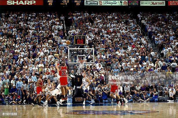 Michael Jordan of the Chicago Bulls shoots a threepointer in Game Five of the 1997 NBA Finals against the Utah Jazz at the Delta Center on June 11...