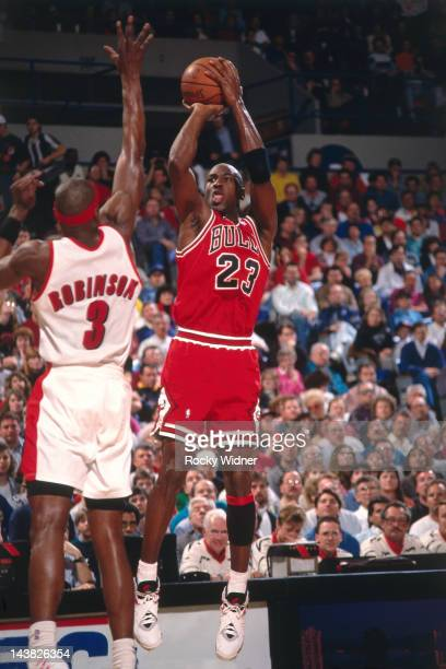 Michael Jordan of the Chicago Bulls shoots against Cliff Robinson of the Portland Trailblazers on February 7 1993 at Veterans Memorial Coliseum in...