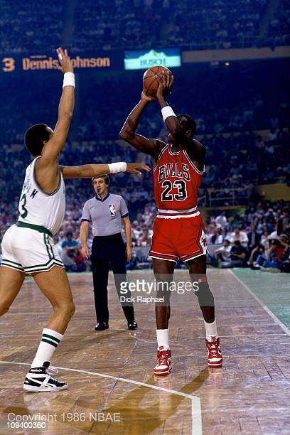 Michael Jordan of the Chicago Bulls shoots against Dennis Johnson of the Boston Celtics during Game 2 of the Eastern Conference quarterfinals during...