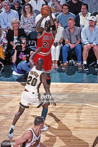 Michael Jordan of the Chicago Bulls shoots against Gary Payton of the Seattle Supersonics during Game Five of the 1996 NBA Finals on June 14 1996 at...