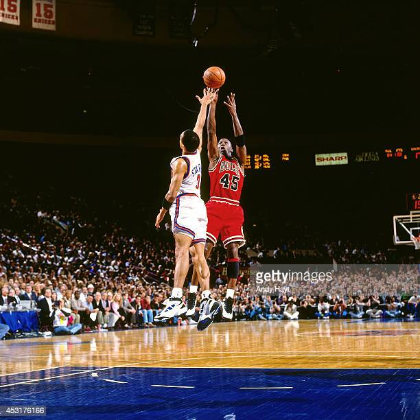 Michael Jordan of the Chicago Bulls shoots against John Starks of the New York Knicks on March 28 1995 at Madison Square Garden in New York City...